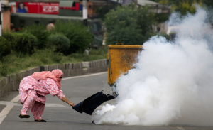 Woman & tear gas canister in Srinagar ( Cathal McNaughton:Reuters) Aug 18 2016