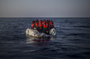 African refugees in punctured dinghy (Santi Palacios:AP) Sept 17 2016