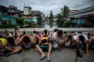 Manila drug roundup in slum (- Noel Celis:AFP:Getty Images) Oct 11 2016
