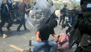 Israeli riot police & Palestinian (AHMAD GHARABLI : AFP : GETTY IMAGES) Nov 1 2016