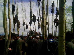 Mourners watching the funeral of Waseem Ahmed Malla in Aglar-Shopian on 7 April 2016. Photo- Javaid Naikoo.