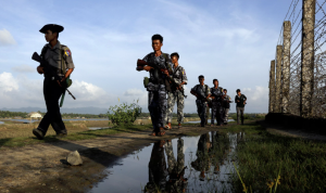 Myanmar police officers patrol the border between Myanmar and Bangladesh in Maungdaw, Rakhine State, in this photo from October. Photograph- Thein Zaw:AP
