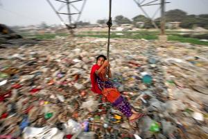 Girl on swing in Dhaka (Mohammad Ponir Hossain:Reuters) Dec 27 2016