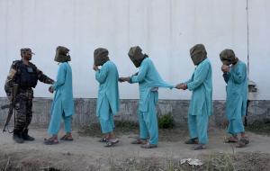 Hooded Afghan POWs (Noorullah Shirzada:AFP:Getty Images) Dec 7 2016