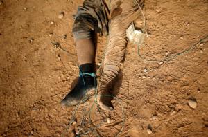 Iraqi body dragged (REUTERS:Mohammed Salem) Dec 5 2016