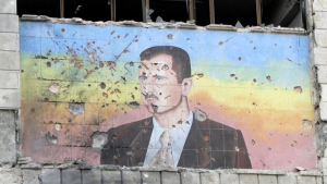 Reuters photo from AJ of Assad mural