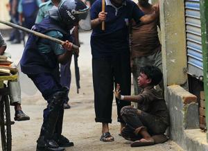 Bangladeshi policeman hits striking child 2010 ( Munir Uz Zaman:AFP:Getty Images)