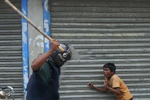 Dhaka policeman hits child striker (Munir Uz Zaman:AFP:Getty Images) 2010