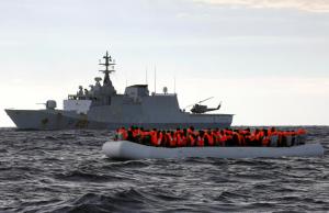 Italian navy vessel and refugee raft (REUTERS:Yannis Behrakis) Jan 3 2016