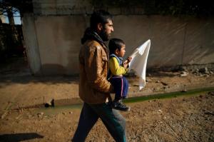 Man & boy fleeing Mosul (REUTERS:Ammar Awad) Jan 5 2016