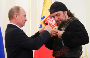 Putin with Night Rider guy (Mikhail Klimentyev : AFP - Getty Images ) Jan 9 2017