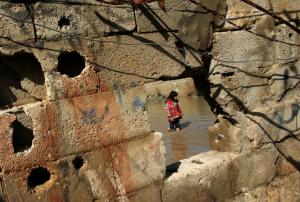Palestinian girl in bombed bldg:flooding (. REUTERS:Mohammed Salem) Feb 20 2017