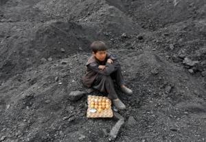 Afghan boy at coal dump Kabul, Afghanistan. REUTERS:Mohammad Ismail: Mar 7 2017