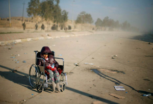 Mosul--IDP child in wheelchair  (Photo by Suhaib Salem:Reuters) Mar 7 2017