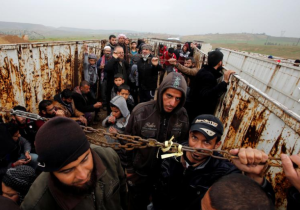 Mosul--displaced Iraqis in cattle truck (REUTERS:Youssef Boudlal) Mar 31 2017