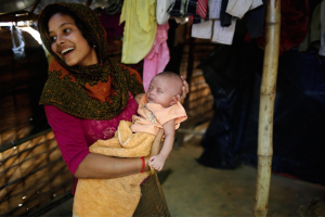Noor Kayes, 18, holds her 26-day-old unnamed daughter. (Reuters) Mar 30 2017