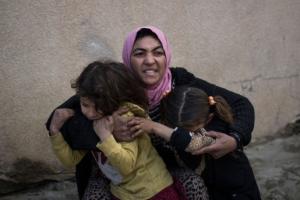 Woman & daughters in Mosul ((AP Photo:Felip) Mar 14 2017