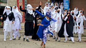 Girl students pelt stones at security personnel during clashes in Lal Chowk in Srinagar.(PTI) Apr 25 2017