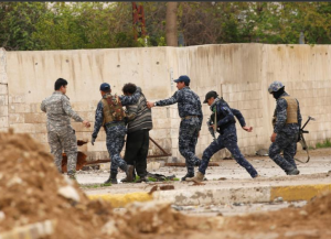 Iraqi soldiers arresting mentally disabled man Mosul (REUTERS:Youssef Boudlal) Apr 3 2017
