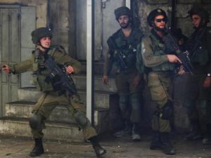 Israeli soldier with tear gas (AP Photo:Nasser Shiyoukhi) Apr 29 2017