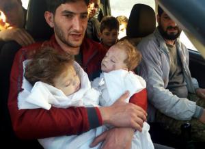 Sabdul-Hamid Alyousef, held his dead twin babies (ALAA ALYOUSEF VIA AP)