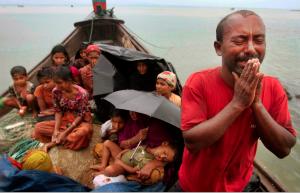 2012 photo of Rohingya man pleading with Bangladesh border guards