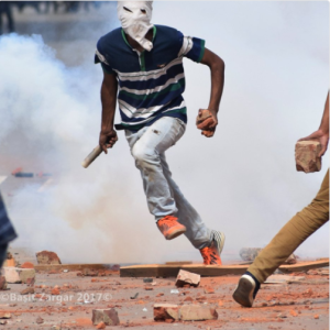 A Kashmiri student prepares to throw a tear-gas canister during clashes between students and government forces in Srinagar. (Basit Zargar) May 9 2017