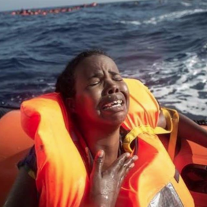 Grieving African mother refugee May 24 2017