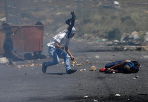 Nakba Day near Ramallah injured protester (REUTERS:Mohamad Torokman) May 17 2017