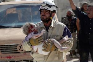 White Helmet with injured child Idlib Oct 2015 :Khalil Ashawi:Reuters: May 9 2017