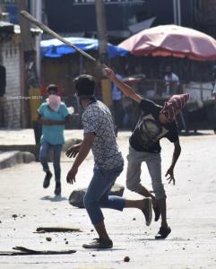 Kashmiri throws wooden plant at police & paramilitary men in Srinagar July 25 2017 )Basit Zargar