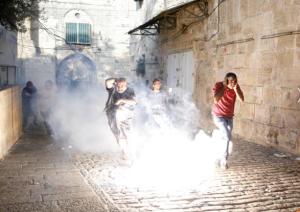 Palestinians outside Al Aqsa July 27 (REUTERS:Amir Cohen) July 28 2017