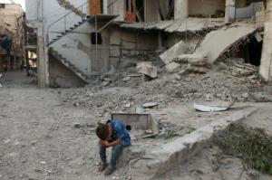 Syrian boy after bombing of Arbin (REUTERS:Bassam Khabieh) July 26 2017
