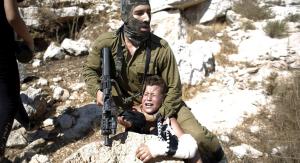 Tamimi boy with broken arm & Israeli soldier 2015 (Reuters)
