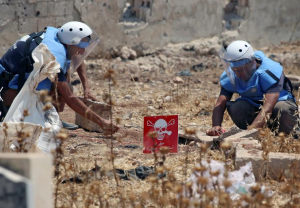 White Helmets clearing cluster munitions (Reuters:Alaa al-Faqie) July 28 2017