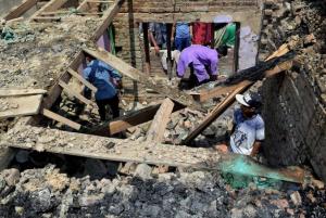 House destroyed in gunfight Kashmir (Bilal Ahmad) Aug 11 2017