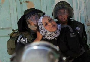 IDF women soldiers and Palestinian woman August 1 2017