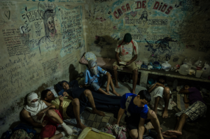 In a jail cell outside Caracas. Many who have been arrested turned to crime because of the country's economic woes. Credit Meridith Kohut for The New York Times Aug 4 2017