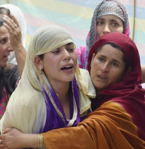 Wife of Firdous Ahmad at his funeral procession in Kashmir 1 Aug 2017