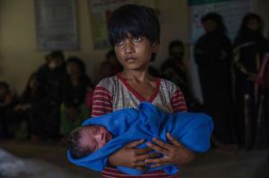 Afeefa Bebi Rohingya girl with baby (ABC News) Sept 15 2017