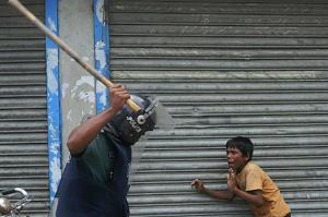 Bangladesh boy garment worker (2) (Photos all by Munir Uz Zaman:AFP:Getty Images) Sept 27 2017
