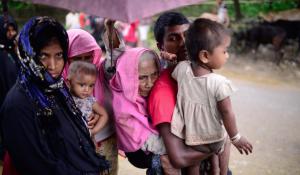 Kamal Hossain 25, carried 105 yr old grandmother to Bangladesh after village burned to ground (Mahmud Hossain:Opu:AI Jazeera) Sept 28 2017