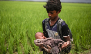 Ro boy with infant (CNN) Sept 20 2017