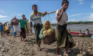 Ro refugees carrying elderly woman (CNN) Sept 22 2017