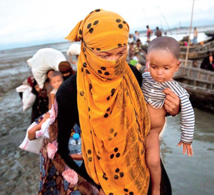 Ro woman with child getting off boat (AP) Sept 27 2017