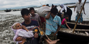 Rohingya carrying senior woman (Bernat Armangue:AP) Sept 4 2017