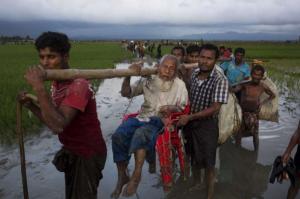 Rohingya elderly man being carried (Bernat Armangue:AP) Sept 8 2017