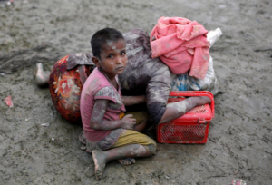 Rohingya girl & exhausted mom (Danish Siddiqui:Reuters) Sept 7 2017