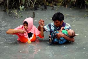 Rohingya in river 2017 Mohammad Ponir Hossain:Reuters: Sept 12 2017