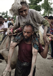 Rohingya man carrying father on shoulders Sept 12 2017